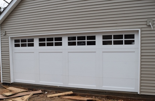 Precision Door Service will fix your garage door right!
